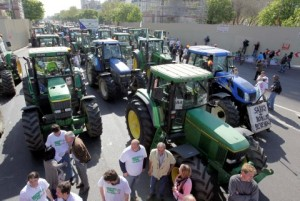 French farmers gather tractors as they prepare to demonstrate in Paris, Tuesday, April 27, 2010. Thousands of tractors invade Paris in a protest by farmers from the French heartland, frustrated over sinking income and demanding tax cuts and government help in getting export credits.(AP Photo/Thibault Camus)