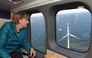 ZINGST, GERMANY - MAY 02: In this photo provided by the German Government Press Office German Chancellor Angela Merkel attends a helicopter flight over Germany's first commercial offshore wind farm on May 2, 2011 in the Baltic Sea near Zingst, Germany. German Chancellor Angela Merkel has vowed to invest heavily into offshore wind farms as part of an overall policy to encourage renewable energy production. EnBW Offshore Windpark Baltic 1 begins operation today. (Photo by Guido Bergmann/Bundesregierung-Pool via Getty Images)